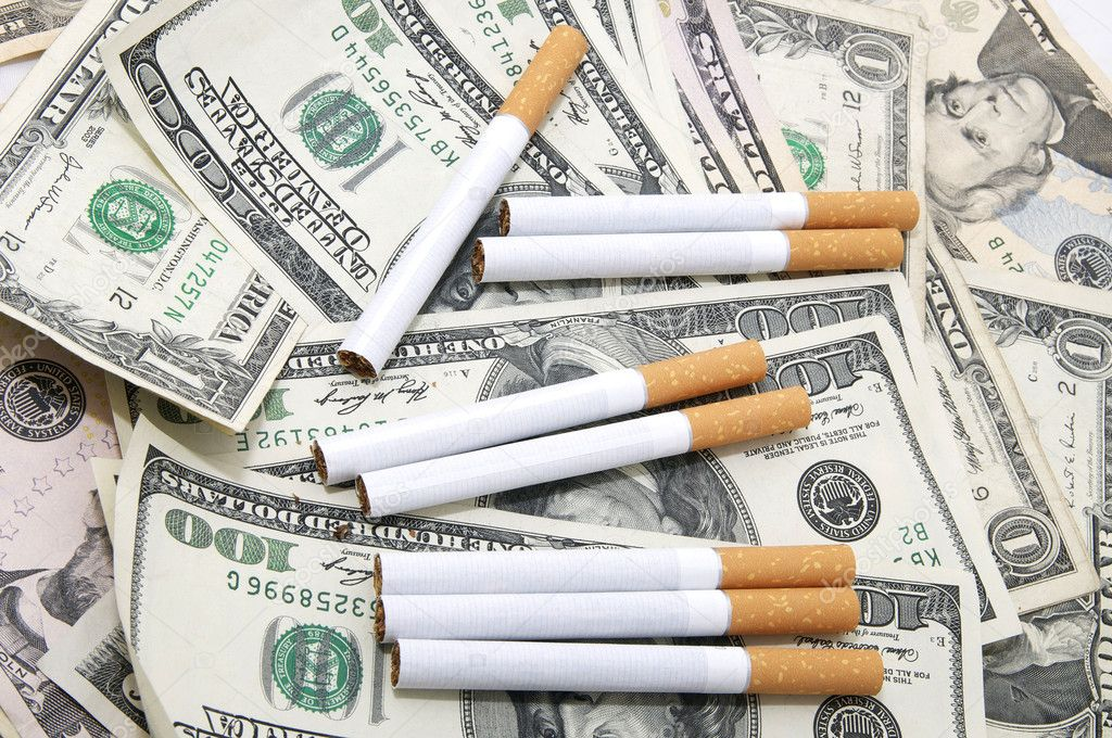 depositphotos 10758888 stock photo cigarettes and money